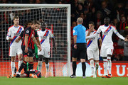 Mamadou Sakho of Crystal Palace fouls Jefferson Lerma of AFC Bournemouth which leads to Bournemouth being awarded a penalty by Referee Mike Dean during the Premier League match between AFC Bournemouth and Crystal Palace at Vitality Stadium on October 1, 2018 in Bournemouth, United Kingdom.
