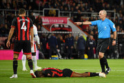 Jefferson Lerma of AFC Bournemouth lays on the floor after being fouled by Mamadou Sakho of Crystal Palace (not pictured) as match Referee Mike Dean awards Bournemouth a penalty during the Premier League match between AFC Bournemouth and Crystal Palace at Vitality Stadium on October 1, 2018 in Bournemouth, United Kingdom.