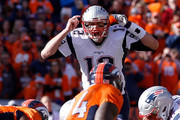 Tom Brady #12 of the New England Patriots gestures at the line of scrimmage in the first quarter against the Denver Broncos in the AFC Championship game at Sports Authority Field at Mile High on January 24, 2016 in Denver, Colorado.