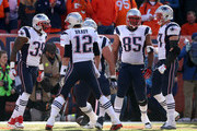 Steven Jackson #39 and Tom Brady #12 of the New England Patriots celebrate after a 1-yard touchdown run by Jackson in the first quarter against the Denver Broncos in the AFC Championship game at Sports Authority Field at Mile High on January 24, 2016 in Denver, Colorado.