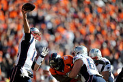 Tom Brady #12 of the New England Patriots passes in the first quarter against the Denver Broncos in the AFC Championship game at Sports Authority Field at Mile High on January 24, 2016 in Denver, Colorado.