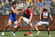 Josh Kennedy of the Eagles and Sam Frost of the Demons contest for the ball during the AFL Prelimary Final match between the West Coast Eagles and the Melbourne Demons on September 22, 2018 in Perth, Australia.