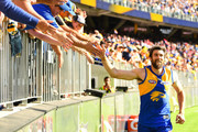 Josh Kennedy of the Eagles celebrates with the fans during the 2018 AFL Second Preliminary Final match between the West Coast Eagles and the Melbourne Demons at Optus Stadium on September 22, 2018 in Perth, Australia.