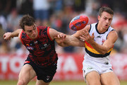 Tim Smith of the Demons and Tom Doedee of the Crows compete for the ball during the round 10 AFL match between the Melbourne Demons and the Adelaide Crows at Traeger Park on May 27, 2018 in Alice Springs, Australia.