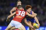 Ed Richards of the Bulldogs is tackled by Tim Smith of the Demons during the round 11 AFL match between the Western Bulldogs and the Melbourne Demons at Etihad Stadium on June 2, 2018 in Melbourne, Australia.