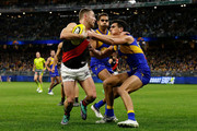 Devon Smith of the Bombers fends off Tom Cole of the Eagles during the round 14 AFL match between the West Coast Eagles and the Essendon Bombers at Optus Stadium on June 21, 2018 in Perth, Australia.