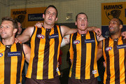 Sam Mitchell, David Hale, Jarryd Roughead and Josh Gibson of the Hawks sing the song in the rooms after winning the round 15 AFL match between the Hawthorn Hawks and the Greater Western Sydney Giants at the Melbourne Cricket Ground on July 8, 2012 in Melbourne, Australia.