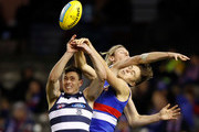 (L-R) Jack Henry of the Cats, Mark Blicavs of the Cats and Josh Schache of the Bulldogs compete for the ball during the 2018 AFL round15 match between the Western Bulldogs and the Geelong Cats at Etihad Stadium on June 29, 2018 in Melbourne, Australia.