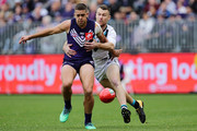 Stephen Hill of the Dockers is tackled by Robbie Gray of the Power during the round 17 AFL match between the Fremantle Dockers and the Port Adelaide Power at Optus Stadium on July 15, 2018 in Perth, Australia.