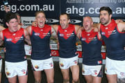 Angus Brayshaw, Bernie Vince, Daniel Cross, Nathan Jones and Chris Dawes of the Demons sing the song in the rooms after winning the round 18 AFL match between the Collingwood Magpies and the Melbourne Demons at Melbourne Cricket Ground on August 1, 2015 in Melbourne, Australia.