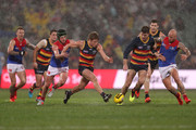 Angus Brayshaw of the Demons tackles Rory Sloane of the Crows during the 2018 AFL round 19 match between the Adelaide Crows and the Melbourne Demons at Adelaide Oval on July 28, 2018 in Adelaide, Australia.