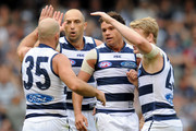 (L-R) Paul Chapman, James Podsiadly,Steven Motlop and Josh Caddy celebrate  a goal for the cats during the round two AFL match between the Geelong Cats and the North Melbourne Kangaroos at Etihad Stadium on April 7, 2013 in Melbourne, Australia.