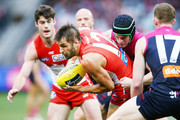 Josh Kennedy of the Swans is tackled by Angus Brayshaw of the Demons during the round 21 AFL match between the Melbourne Demons and the Sydney Swans at Melbourne Cricket Ground on August 12, 2018 in Melbourne, Australia.