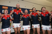 Nathan Jones of the Demons leads the singing of the team soong after winning the round 22 AFL match between the West Coast Eagles and Melbourne Demons at Optus Stadium on August 19, 2018 in Perth, Australia.