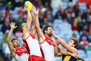 Nick Smith, Ted Richards and Heath Grundy of the Swans compete for the ball against Ben Griffiths of the Tigers during the round 23 AFL match between the Sydney Swans and the Richmond Tigers at ANZ Stadium on August 30, 2014 in Sydney, Australia.
