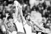 Image has been converted to black and white.) Nick Smith, Ted Richards and Heath Grundy of the Swans compete for the ball against Ben Griffiths of the Tigers during the round 23 AFL match between the Sydney Swans and the Richmond Tigers at ANZ Stadium on August 30, 2014 in Sydney, Australia.