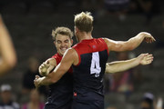 Tim Smith of the Demons celebrates with  Jack Watts of the Demons after kicking his first goal in the AFL during the round three AFL match between the Geelong Cats and the Melbourne Demons at Etihad Stadium on April 8, 2017 in Melbourne, Australia.