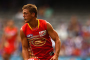 Daniel Harris of the Suns runs the ball out of the back line during the round three AFL match between the Western Bulldogs and the Gold Coast Suns at Etihad Stadium on April 9, 2011 in Melbourne, Australia.