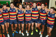 Crows players celebrate in the rooms after the round four AFL match between the Adelaide Crows and the Sydney Swans at Adelaide Oval on April 16, 2016 in Adelaide, Australia.