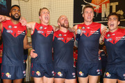 Heritier Lumumba, James Harmes, Nathan Jones, Tom McDonald and Jack Viney of the Demons sing the song in the rooms after winning the round five AFL match between the Melbourne Demons and the Richmond Tigers at Melbourne Cricket Ground on April 24, 2016 in Melbourne, Australia.