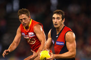 Jobe Watson of the Bombers breaks clear of Daniel Harris of the Suns during the round six AFL match between the Essendon Bombers and the Gold Coast Suns at Etihad Stadium on May 1, 2011 in Melbourne, Australia.