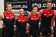 Tom McDonald, Nathan Jones, Jack Grimes and Jake Spencer of the Demons sing the song in the rooms after winning the round eight AFL match between the Melbourne Demons and the Western Bulldogs at Melbourne Cricket Ground on May 24, 2015 in Melbourne, Australia.
