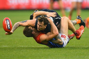 Cameron O'Shea of the Blues is tackled by Tim Smith of the Demons during the round nine AFL match between the Carlton Blues and the Melbourne Demons at Melbourne Cricket Ground on May 20, 2018 in Melbourne, Australia.
