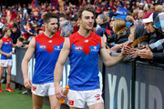 Tim Smith (right) and Jesse Hogan of the Demons thank fans during the 2018 AFL round nine match between the Carlton Blues and the Melbourne Demons at the Melbourne Cricket Ground on May 20, 2018 in Melbourne, Australia.