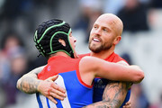 Angus Brayshaw and Nathan Jones of the Demons celebrate a goal during the round nine AFL match between the Carlton Blues and the Melbourne Demons at Melbourne Cricket Ground on May 20, 2018 in Melbourne, Australia.