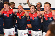 Aaron Vandenberg, Nathan Jones, Jack Viney and Jake Melksham of the Demons sing the song in the rooms after winning the AFL Semi Final match between the Hawthorn Hawks and the Melbourne Demons at the Melbourne Cricket Ground on September 14, 2018 in Melbourne, Australia.