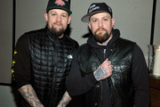 (L-R) Musicians Joel Madden and Benji Madden attend AG + Vanity Fair: Opening of Saved on December 8, 2016 in Los Angeles, California.