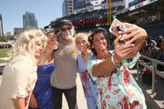 Greg Nicotero takes a photo with fans at The Walking Dead Walker Horde at Petco Park during Comic Con 2019 on July 20, 2019 in San Diego, California.