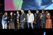 (L-R) Lauren Cohan, Angela Kang, Scott Gimple, Robert Kirkman, Dave Alpert, Jeffrey Dean Morgan, Norman Reedus, and Danai Gurira speak onstage during a panel for AMC's The Walking Dead Universe including AMC's flagship series and the untitled new third series within The Walking Dead franchise at Hulu Theater at Madison Square Garden on October 05, 2019 in New York City.