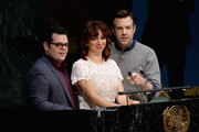 """(L-R) Actors Maya Rudolph, Josh Gad and Jason Sudeikis speak on stage during the United Nations Ceremony, Presentation and Photo Call naming Red, from the """"ANGRY BIRDS"""" movie, Honorary Ambassador for the International Day of Happiness, to be observed around the world on March 20th, at United Nations on March 18, 2016 in New York City."""