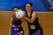 Maria Tutaia of the Mystics (L) and Casey Williams of the Magic contest the ball during the ANZ Championship Preliminary Final between the Northern Mystics and the Bay of Plenty Magic on July 16, 2012 in Auckland, New Zealand.