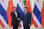 Thailand's Prime Minister Prayut Chan-O-Cha (L) meets with Chinese President Xi Jinping (R) during APAC Bilateral Meeting at the Great Hall of the People on November 9, 2014 in Beijing, China.