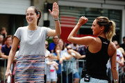 Ana Ivanovic and TV presenter Makere Bradnam celebrate a point during an exhibition tennis match withon January 3, 2016 in Auckland, New Zealand. The ASB Classic starts on Monday 4, 2016.