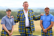 Russell Knox of Scotland, former rugby player Doddie Weir and David Howell of England pose for a photo on Tartan Wednesday before the Pro-Am event of the Aberdeen Standard Investments Scottish Open at Gullane Golf Course on July 11, 2018 in Gullane, Scotland.
