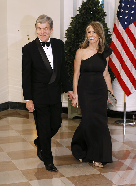 Guests Arrive For State Dinner At The White House Honoring Australian PM Morrison [roy blunt,morrison,state dinner,guests,abigail perlman blunt,l,r,mo,suit,formal wear,clothing,tuxedo,dress,standing,event,fashion,human,little black dress,australian,white house]