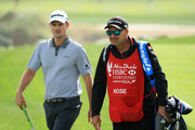 Justin Rose of England walks with his caddie Mark Fulcher on the seventh hole during the final round of the Abu Dhabi HSBC Golf Championship at Abu Dhabi Golf Club on January 21, 2018 in Abu Dhabi, United Arab Emirates.