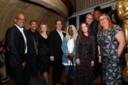 """(L-R) AMPAS New York director of programs and membership Patrick Harrison, production designer Wynn Thomas, AMPAS CEO Dawn Hudson, AMPAS president David Rubin, actress Whoopi Goldberg, actress Julianne Moore, AMPAS governor Bernard Telsey, director Roger Ross Williams and AMPAS governor Laura Karpman attend The Academy of Motion Picture Arts and Sciences """"2019 New Members Party"""" at the Top of the Standard in New York on October 1, 2019 in New York City."""