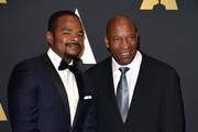Directors F. Gary Gray (L) and John Singleton attend the Academy of Motion Picture Arts and Sciences' 7th annual Governors Awards at The Ray Dolby Ballroom at Hollywood & Highland Center on November 14, 2015 in Hollywood, California.