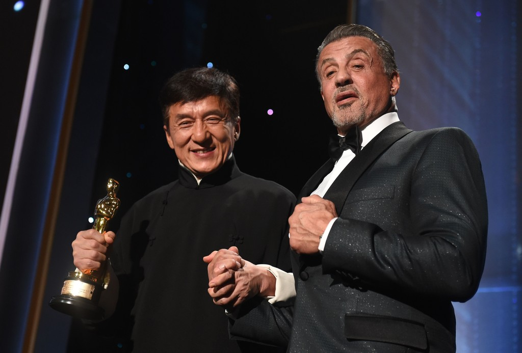 Jackie Chan with Rambo holding award