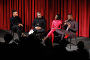 (L-R) Moderator KC Ifeanyi, director Jordan Peele and actors Lupita Nyong'o and Winston Duke on stage during The Academy of Motion Picture Arts and Sciences official screening of Us at the MoMA Celeste Bartos Theater on March 18, 2019 in New York City.