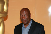"""Director John Singleton attends the """"Spotlight On Screenwriting: Boyz n the Hood 25th Anniversary Screening With John Singleton And Walter Mosley"""" presented by The Academy Of Motion Picture Arts And Sciences at SVA on June 12, 2016 in New York City."""
