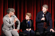 (L-R) Writer, director, producer Taika Waititi, actor Roman Griffin Davis and producer Carthew Neal on stage during The Academy of Motion Pictures Arts and Sciences official Academy screening of JoJo Rabbit at the MoMA Celeste Bartos Theater on October 17, 2019 in New York City.