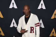 """John Singleton attends the Academy Presents """"Grease"""" (1978) 40th Anniversary at the Samuel Goldwyn Theater on August 15, 2018 in Beverly Hills, California."""