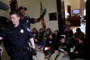 Washington area students sit and protest in front of Senate Majority Leader Mitch McConnell's (R-KY), office to urge Congress into changing gun laws in the wake of the high school massacre in Parkland, Florida last month, on Capitol Hill, March 7, 2018 in Washington, DC.
