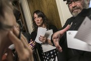 Kate Simson, center, with Sen. Susan Collins' office, listens to protestors and takes comment cards during a sit-in protest against the confirmation of Brett Kavanaugh at Sen. Collins' office on September 28, 2018 in Portland, Maine. Sen. Jeff Flake (R-AZ) was crucial in getting the committee to agree to an additional week of investigations into accusations of sexual assault against Kavanaugh before the full Senate votes. A day earlier the committee heard from Kavanaugh and Christine Blasey Ford, a California professor who has accused Kavnaugh of sexually assaulting her during a party in 1982 when they were high school students in suburban Maryland.