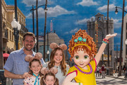 In this handout photo provided by Disneyland Resort, actress Alyson Hannigan (center), her (l-r) husband Alexis Denisof,  daughters Satyana and Keeva pose with Disney Junior star Fancy Nancy, after a welcome ceremony for the character who meets guests daily on May 3, 2019 at Disney California Adventure Park in Anaheim, California. Hannigan voices Fancy Nancys mom, Claire, in the animated family comedy Fancy Nancy airing on Disney Channel, Disney Junior and the DisneyNow app.